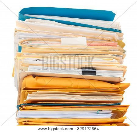 Huge Stack Of Well Worn File Folders, Manilla Envelopes, And Papers Viewed From A Low Angle And Isol