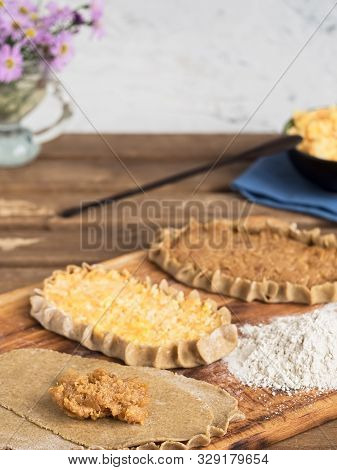 Cooking National Dishes Karelian Pies. In The Foreground Pies Prepared For Baking. A Traditional Dis