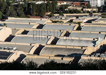 Burbank, California, USA - October 20, 2019:  Morning view of historic sound stages with curved rooftops at the Warner Bros studio lot near Los Angeles.