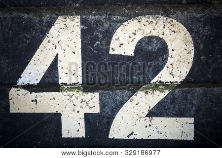 Number Forty Two In Bold Figures On Black Background