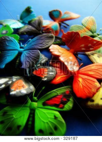 Toy butterflies on blue  background poster