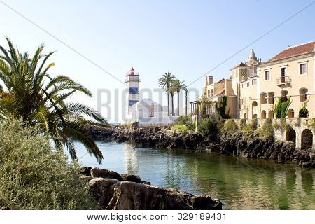 Beautiful View Of The Beach, Lighthouse  And Villa On The Sunny Day. Cascais. Portugal.