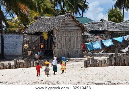 Pingwe, Zanzibar - October 6, 2019: Group Of Children In The Pingwe Village. Tanzania, Africa