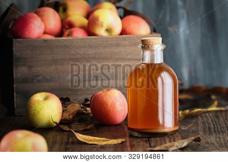 Apple Cider Vinegar With The Mother, Yeast And Healthy Bacteria, Surrounded By Fresh Apples. Apple C