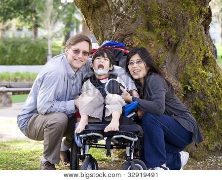 Disabled Child Surrounded By Parents