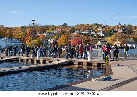 Bayfield, Wisconsin - October 19, 2019: Tourists Line Up To Board A Boat Cruise Tour To The Apostle