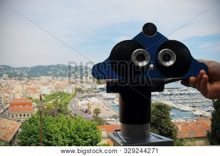 Man's Hand Holding A Telescope Ready To Observe The City Landscape