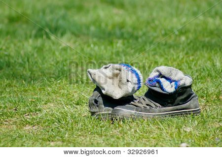 Old Shoes Lying In A Grass