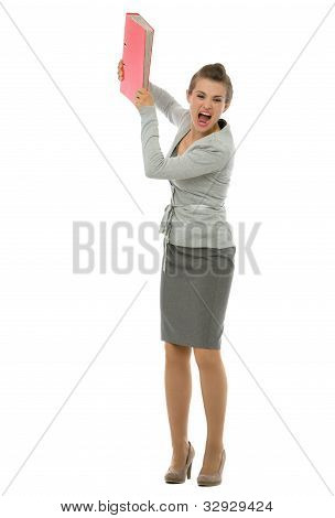 Full Length Portrait Of Angry Business Woman Throwing Folder In Rage