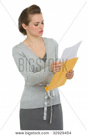 Concerned Woman Reading Letter