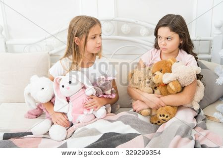 Greedy Kids Concept. Sisters Relations Issues. Share Toys With Friends. Children In Bedroom Play Toy