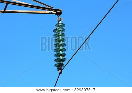 Layered High Quality Tall Glass Power Line Utility Insulators Holding Single Black Electrical Wire O