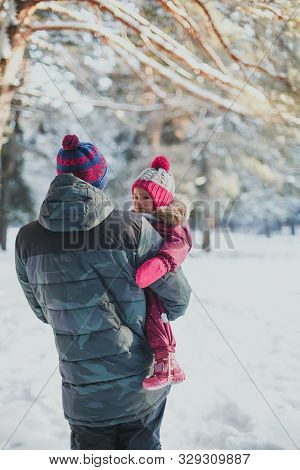 Winter Walk With A Child: Dad And Daughter Walk In The Winter Forest
