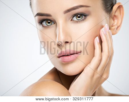 Young caucasian woman with beautiful face - isolated on white. Skin care concept.