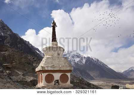 Stupa Or Chedi In Maitreya Buddha Statue And Diskit Monastery Or Deskit Gompa Perched Against The Hi