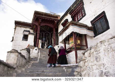 Tibetan Pilgrim People Walk On Stone Stairs Step Up Approach To Diskit Monastery Galdan Tashi Chulin