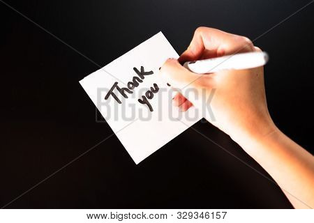 Writing Thank you! Sticky note with text Thank You! Text Thank you on paper.