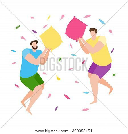 Young Gay Couple Having Fun At A Pajama Sleepover Party. Two Guys Fight With Pillows. Colorful Conce