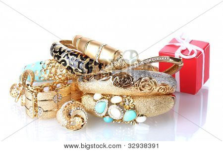 Beautiful golden jewelry and gift box isolated on white