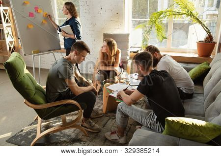 Group Of Young Caucasian Office Workers Meeting To Discuss New Ideas. Creative Meeting. Teamwork And