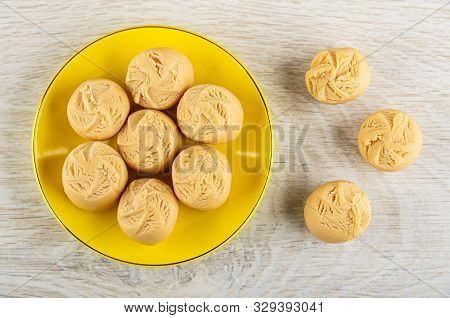 Few Creamy Fudge In Yellow Saucer, Fudge On Light Wooden Table. Top View