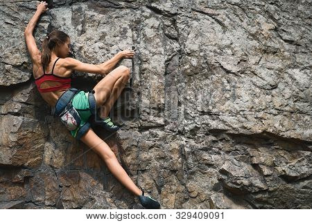 Sports Woman With Slim Fit Body Climbing The Rock Having Workout In Mountains. Rock Climbing Hard Mo