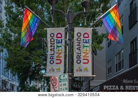 Orlando, Florida. October 12, 2019. Orlando United Signs And Rainbow Flags In Come Out With Pride Or