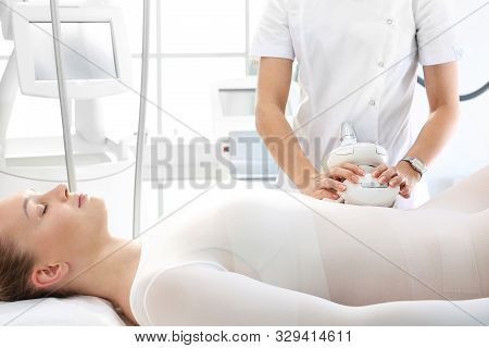 Flat Stomach, A Woman During A Vacuum Massage Treatment Using A Professional Device. Endermologie