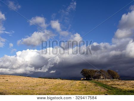 Wales - The Northern Countryside Near Caernarfon: An Autumn Day.  A Passing Storm Over Hayfields.