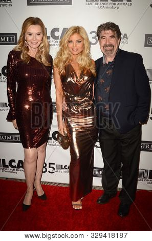 LOS ANGELES - OCT 19:  Michelle Berk, Donna D'Errico, Michael Berk at the Last Chance for Animals' 35th Anniversary Gala at the Beverly Hilton Hotel on October 19, 2019 in Beverly Hills, CA