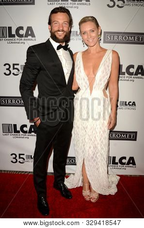 LOS ANGELES - OCT 19:  Kyle Schmid, Nicky Whelan at the Last Chance for Animals' 35th Anniversary Gala at the Beverly Hilton Hotel on October 19, 2019 in Beverly Hills, CA
