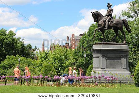 Boston, Usa - June 9, 2013: People Visit Washington Monument At Public Garden In Boston. Public Gard