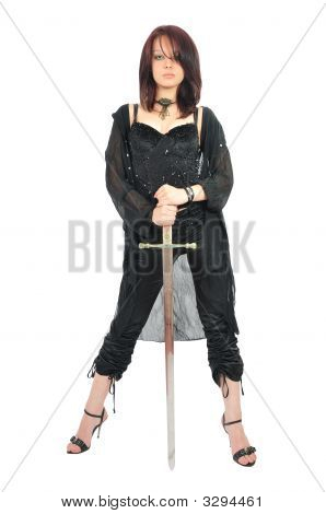 Attractive Girl In Black Stay Holding Sword In Her Hands