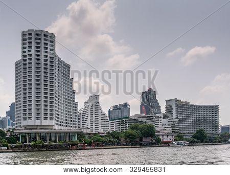 Bangkok City, Thailand - March 17, 2019: Chao Phraya River. New And Old High Rise Buildings And Gard