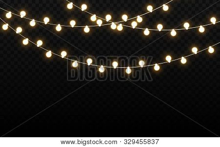 Christmas Lights Isolated On Dark Backdrop. Realistic Light Bulbs. Glowing Wire With Bright Lights.
