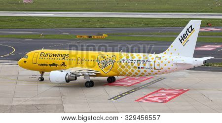 Airplane Taxi In Dusseldorf Airport