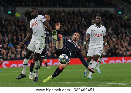 LONDON, ENGLAND - OCTOBER 22 2019: Tottenham's Davinson Sanchez and Red Star Belgrade's Tomane compete for the ball at the UEFA Champions League match between Tottenham Hotspur and Red Star Belgrade