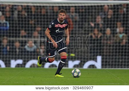 LONDON, ENGLAND - OCTOBER 22 2019: Red Star Belgrade's Milos Degenek during the UEFA Champions League match between Tottenham Hotspur and Red Star Belgrade, at Tottenham Hotspur Stadium