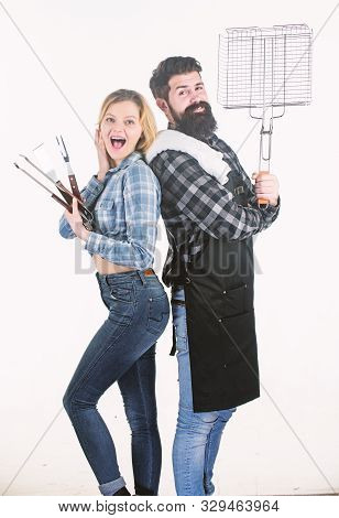 Family Barbecue. Pretty Woman And Bearded Man Holding Cooking Grate. Happy Couple Using Grid For Coo