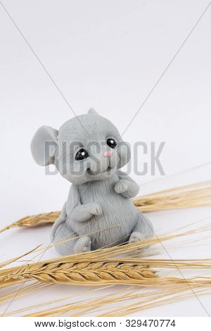 Mouse With Ears Of Wheat Sitting On A White Background