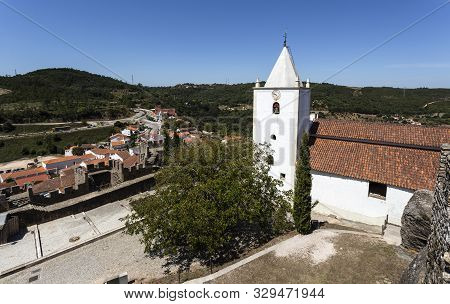 Penela - August 20, 2019: View Of The Church Of Sao Miguel And The Village Of Penela From The Top Of