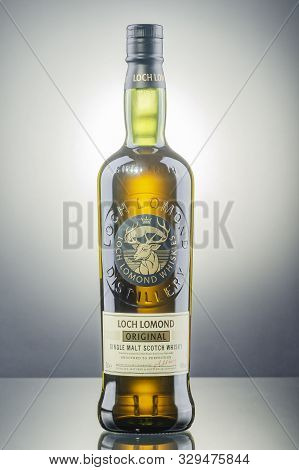 Loch Lomond Whisky On Gradient Background. Loch Lomond Distillery Is A Highland Single Malt Scotch W
