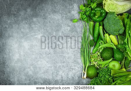 Fresh Green Fruit And Green Vegetables Mixed Background , Top View Various For Healthy Food Vegan Co