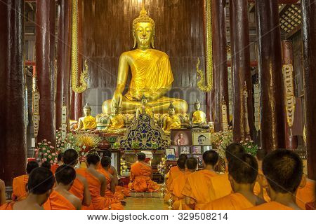 Chiang Mai, Thailand - November 04, 2014: Buddhist Monks Meditating In Front Of The Buddha Image In