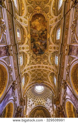 Rome, Italy - March 24, 2019  Tall Arches Nave Ceiling Rome, Italy - March 24, 2019 Fresco Saint Lou