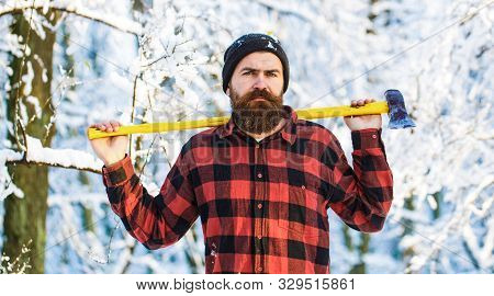 Male Holds An Ax On A Shoulder. Brutal Bearded Man. Handsome Man, Hipster In Snowy Forest. Bearded L