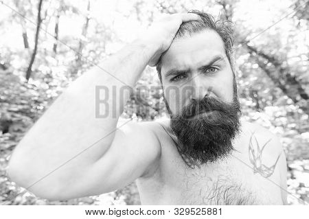 Sweating And Body Odor Care. Perspiring Hipster Touching His Wet Hair. Bearded Man Experiencing Swea