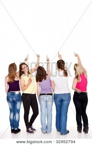 funny teenager girls pointing in copy space above them showing,