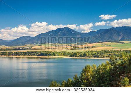 Landscape With The Low Tatras Mountain Range, View From The Liptovska Mara Dam, Slovakia, Europe.