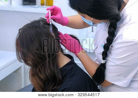 Vitamins For Hairs. Doctor Trichologist Making Injections Mesotherapy In Young Woman Skin Head For H